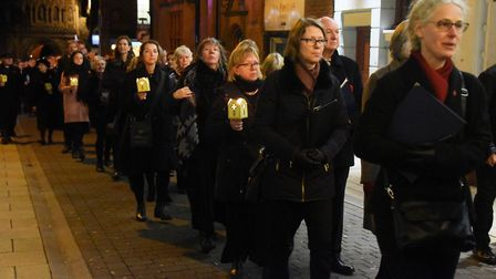 The procession of light makes it's way from Norwich Cathedral to City Hall for Armistice Day. Pictur