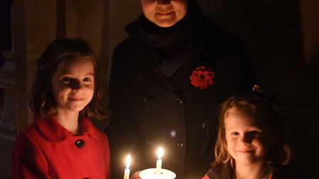 Esther Platten, with her daughters, Charlotte, nine, and Lucy, six, with their lit candles during th