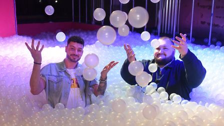 General manager Levi Solomon, left, and manager Jack Ward, enjoying the new ball pit at Bished night
