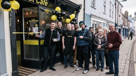 Nick Conrad cuts the ribbon at the official opening of That Café in Norwich in February. Photo: That