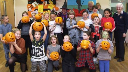 Five members of Swaffham and District Lions helped with pumpkin carving at the Iceni Youth Club ahea