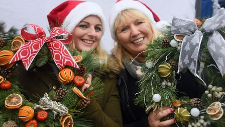 Bespoke florist Millie Brake, left, and her mum, Gill, at the Wymondham Wynterfest with the wreaths