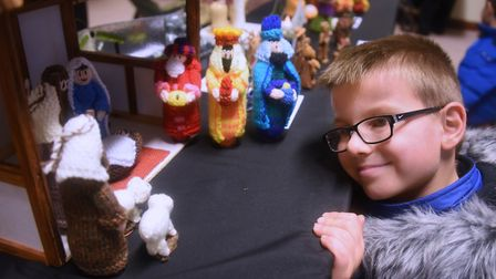 Gilbert Cholwill, seven, takes a look at some of the nativity scenes at the Wymondham Wynterfest. Pi