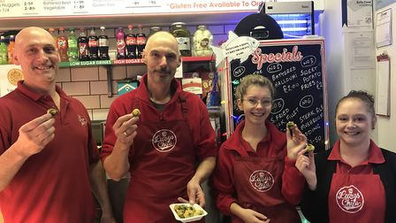 The team at Lucy's Fish and Chips on the market trying their festive deep fried Brussels sprouts