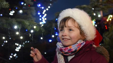 Darcy Andrews, four, by the Christmas tree as the Attleborough lights are switched on. Picture: DENI