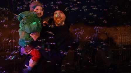 Louis Cossey, two, and his dad Ashley in the bubbles at the Attleborough Christmas Carnival and ligh
