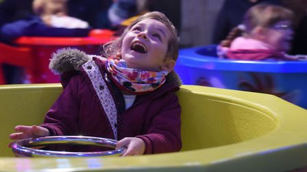 Four-year-old Darcy Andrews enjoying the tea cups ride at the Attleborough Christmas Carnival and li