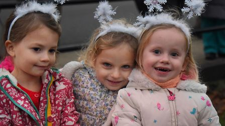 Snowflakes, from left, Iris Howell, four; and sisters Scarlett, four and Amelia Lakutis, three, at t