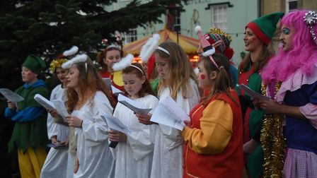 Members of the Attleborough Players sing at the town's Christmas Carnival and lights switch on event