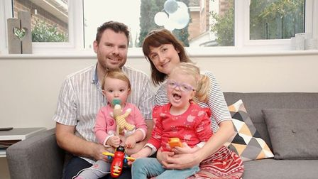 Jonathan and Carly Weeks, with daughters Noa, left, and Ava, right. Photo: East Anglia's Children's