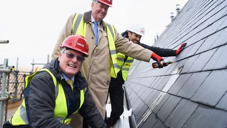 EACH chairman of the trustees, John Pickering, pours beer onto the roof of the almost complete nook
