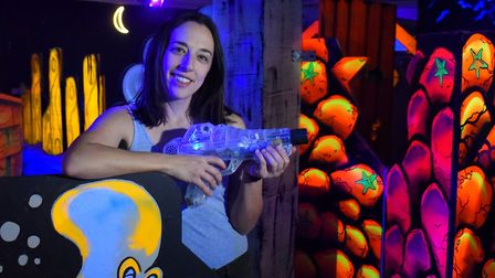 Owner Tirion Davies armed with a phaser in the new Labyrinth Norwich laser tag arena she has opened
