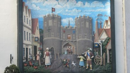 A mural by John Moray-Smith depicting St Stephen's Gate outside the Coachmakers Arms in Norwich. Pic