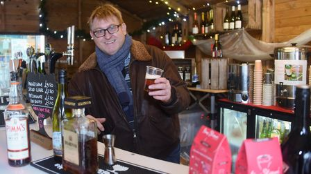 Eddie McGee at work behind the Sleighbells Bar at the Norwich Traditional Christmas Market. Picture: