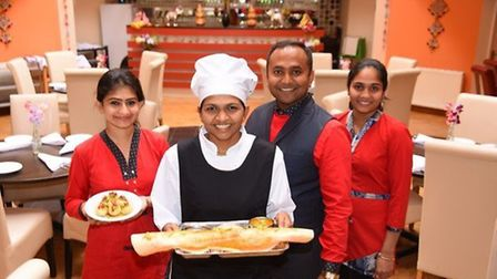 Namaste Village owner Vijay Jetani (second from right) is offering 150 free meals for the homeless o