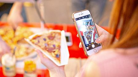 Pizza fan enjoying a One Planet Pizza. The Norfolk company have launched a takeaway service in Norwi