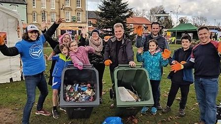 Trash Tribe volunteers joined Daniel Reynolds, founder of Pure Clean Earth, to clear litter in Attle