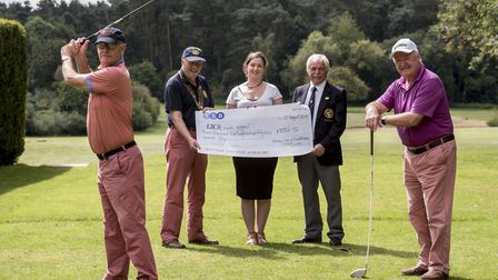 Swaffham Rotary Club members presenting a £3500 cheque raised from an annual charity golf day to EAC