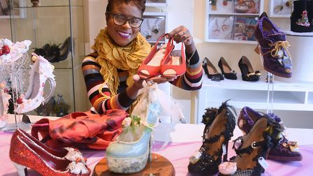 Emily Jupp with some of her creations she makes from upcycling shoes at her shop and studio at Tombl