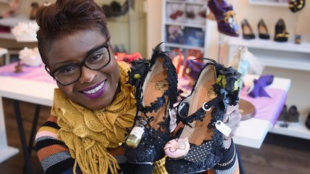 Emily Jupp, holding her Dark Alice shoes, one of her creations she makes from upcycling shoes at her