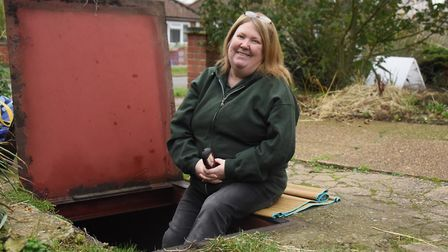 Sonja Gaffer in the entrance to the World War Two air-raid shelter in her front garden. Picture: DEN