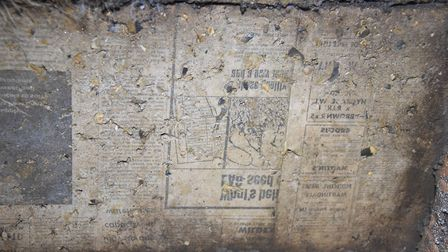 Old EDP and Evening News newspaper print marks the ceiling over the entrance to the World War Two ai