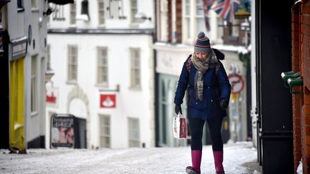 A shopper slowly making their way up an icy Timber Hill. Picture: ANTONY KELLY