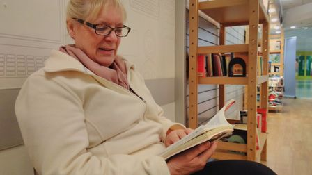 Kim Archer enjoys a book at the honesty library at Castle Mall. Picture: Matt Farmer