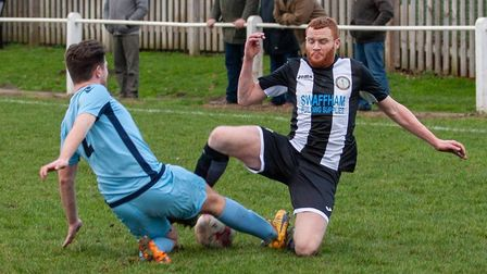 No quarter given as Swaffham Town's Kyle Plumb goes for the ball with a Norwich CBS opponent Picture