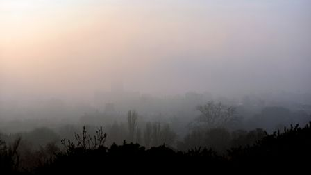 The view of Norwich covered in fog from Mousehold Heath. PICTURE: Jamie Honeywood