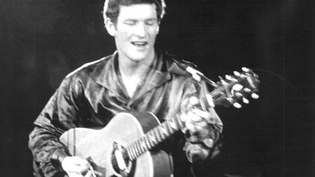 Musician and singer Tony Sheridan performs during a show in Munich in 1963. The singer who performed