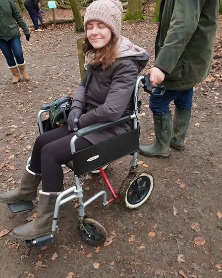 Gemma attempting to use her not fit-for-purpose wheelchair during a family walk over the Christmas b
