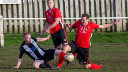 Swaffham Reserves' Aidan Sewell in the thick of the action during his side's comprehensive home win