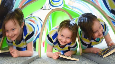 Martha, nine, in the mirrored tunnel under one of the bookcases at the newly refurbished children's
