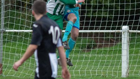 Swaffham Town Reserves keeper Aaron Watson shows a safe pair of hands under pressure from a Beccles