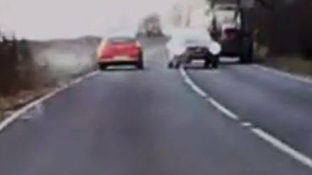 Dashcam footage shows a near miss with mobile roadworks and an oncoming car. PHOTO: Bill Pitwood