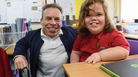 Warwick Davis chats with Connor Reilly, 11, during his visit to the Edith Cavell Academy. Picture: D