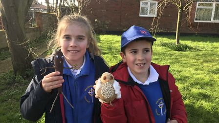 Hannah, 8, in year 3 with Stick Man made from a carrot. Henry, 6, in year 2 with Plop the barn owl f