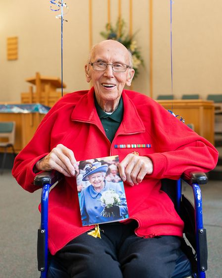 Leonard Boxall shows off his birthday card from the Queen. PHOTO: Macdonald Images 2019