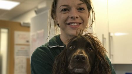 Lottie Sparks from Taverham Vets with her spaniel, Todd at the practices' 25th birthday celebrations
