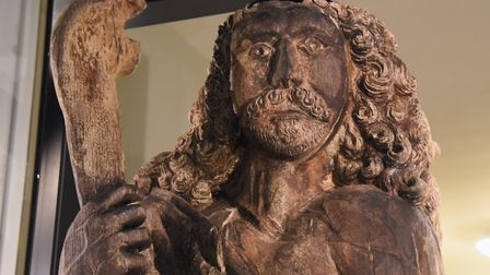 The restored iconic 17th century statue of Samson at the Museum of Norwich at the Bridewell holding