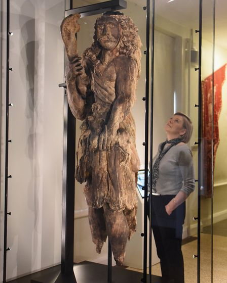 Jenny Caynes, curator, with the iconic 17th century statue of Samson back in Norwich after being res
