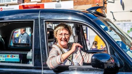 Mayor of Watton Tina Kiddell driving her cab through the town at its carnival earlier this year. Pic