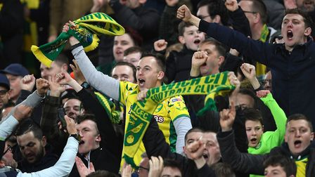 Norwich City fans celebrate during the Sky Bet Championship match at Carrow Road, Norwich. Photo: Jo