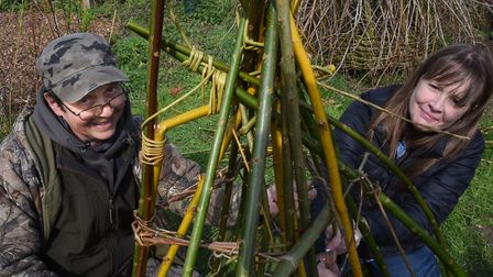 Karen Bek, Escape Project co-ordinator, and Bob Lever, willow weaver, at work creating an organic bo