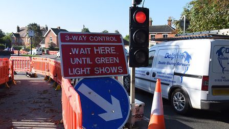 Frustrated drivers go through a red light in the roadworks in Surrogate Street as Attleborough is at