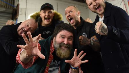 WWE World Champion Mick Foley, front, in Norwich, pictured with the Knight family, as he will be app