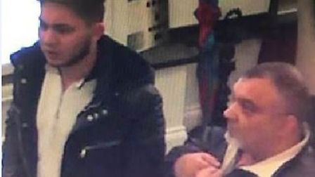 Police are appealing for help to identify two men following a theft in Norwich. Picture: Norfolk Con