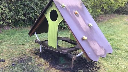 Police are investigating a suspected arson attack on play equipment on Hardingham Road, Hingham. Pho