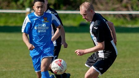 Swaffham Town's Ben Coe is first to the ball against Ipswich Wanderers Picture: EDDIE DEANE
